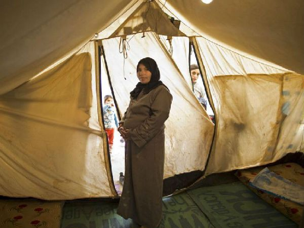 Pregnant woman in tent